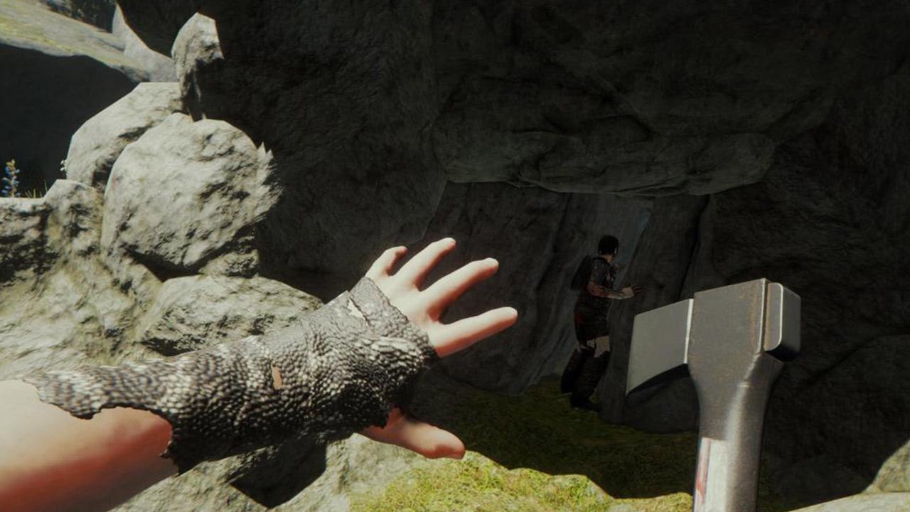 Spieler schleicht hinter einem Menschen in eine Höhle