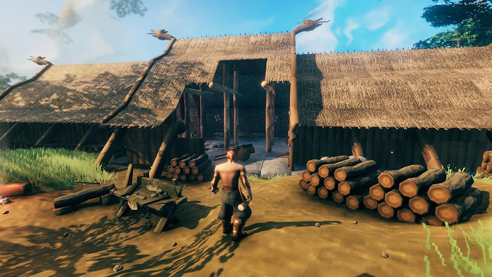 Ein Wikinger in Valheim vor seiner Hütte