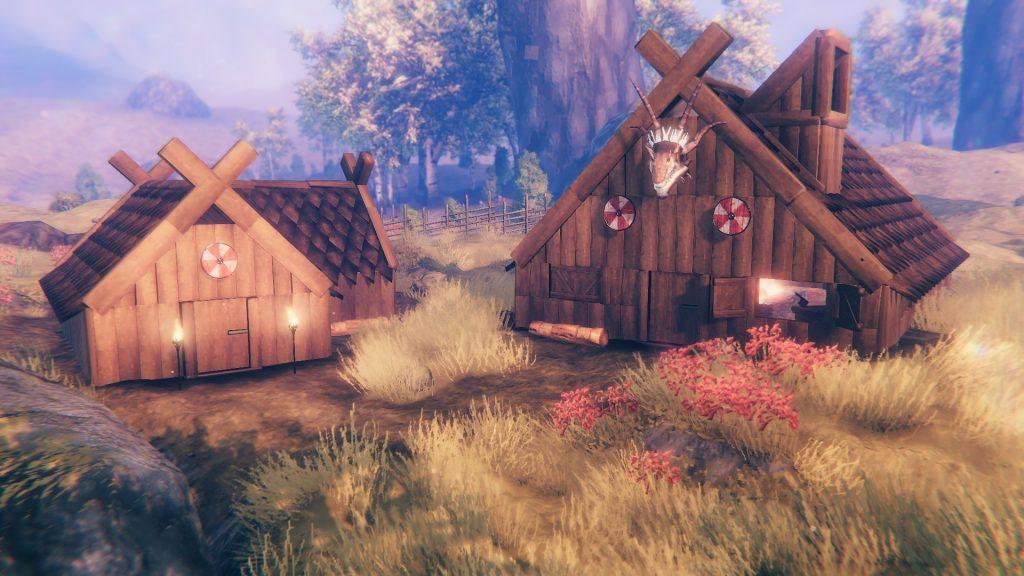 Zwei Holzhäuser im Viking-Stil stehen im Felde